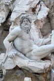 Piazza Navona, Fountain of the Four Rivers detail showing the river-god Ganges Royalty Free Stock Photography