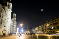 Piazza navona with lighted fountain and the full moon(historic/buildings) Stock Photo