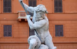 Neptune fighting with an octopus statue in the Fountain of Neptune in Rome. Piazza Navona, Neptune fighting with an octopus statue in the Fountain of Neptune in Royalty Free Stock Photo