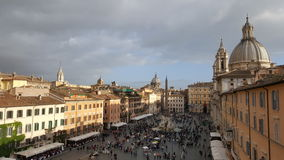 Piazza Navona, Rome, Italy. Tourists in outdoor square of Piazza Navona in Rome, Italy on overcast day stock photos