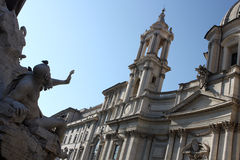 Piazza Navona's church. The image shows part of fountain of four rivers and church of Sant'Agnese.  A legend, common with tour-guides, is that Bernini positioned Royalty Free Stock Photos