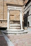 Piazza Pio II, the well Royalty Free Stock Image