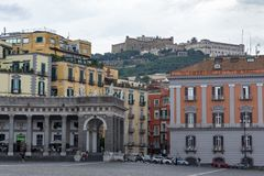 Piazza Plebiscite and Castel Sant`Elmo on hill. Naples landmark. Italian architecture. royalty free stock photo