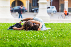Piazza of Prato della Valle, Padova, Italy.Young people relaxing on the grass. PADUA, ITALY - August 5, 2016: Piazza of Prato della Valle, Padova, Italy.Young royalty free stock image