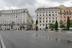 Piazza San Giovanni in Laterano in rainy weather. Rome, Italy. Rome, Italy - August 16, 2015: View from the street Piazza San Giovanni in Laterano in rainy royalty free stock image