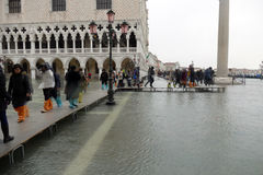 Piazza San Marco flooded. Stock Photos