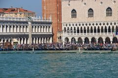 Piazza San Marco, San Marco canal and gondolas, Venice, Italy. Detail of the Doge's Palace on Saint Mark's square, many gondolas in front of it. Venice Royalty Free Stock Photo
