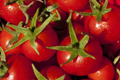 Fresh vibrant cherry tomatoes fill the frame royalty free stock image
