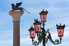 Piazza San Marco. Winged Lion. Piazza San Marco. Two symbol of Venice winged Lion and pink lights Royalty Free Stock Photo