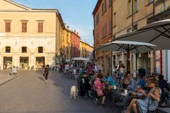 Piazza Trento Trieste in Ferrara, Italy.Square in the historic center of Ferrara, a meeting place of citizenship and tourists. Ferrara, Italy - June 10, 2017 royalty free stock photo