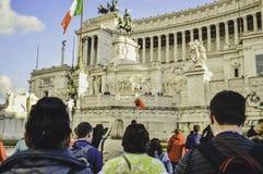 Piazza Venezia, Rome, Italy. Group of tourists walking on the street to go to a famous landmark stock photos