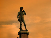 Piazzale Michaelangelo. The statue of Piazzale Michaelangelo in Florence, Italy against the backdrop of the red cloudyskies in the evening Stock Image