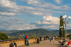 In the Piazzale Michelangelo. Florence, ITALY - Oct 5, 2016. People enjoy the day at Piazzale Michelangelo Royalty Free Stock Image