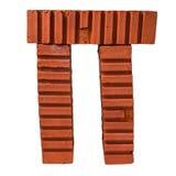Pibokstav som göras av tegelstenar Arkivbild