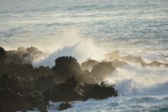 Ocean Break on Lava Stock Image
