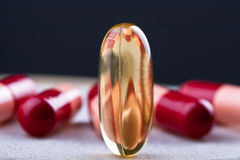 Big omega 3 pill Royalty Free Stock Photography