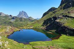 Pic du Midi d Ossau from Anayet plateau in Spanish Pyrenees, Spain royalty free stock image