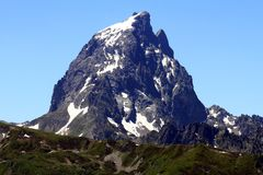 The Pic du Midi d`Ossau in the French Pyrenees. The Pic du Midi d`Ossau 2,884 m is a mountain rising above the Ossau Valley in the French Pyrenees; its Royalty Free Stock Photo