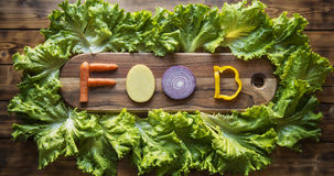 Pic food. The word food written with vegetables Stock Photos