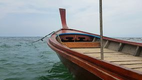 Longtailboat on Andaman Sea in Thailand. PIC shows longtailboat on the Andaman sea - colours blue red brown green. Cloudy scenery for postcards or background Royalty Free Stock Photo