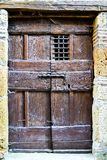 Old wooden door in stone house wall. royalty free stock images