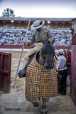 Picador bullfighter going out of the bullring on having finished its work in the spectacle in Baeza Royalty Free Stock Photo