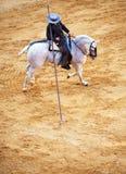 Picador på hästrygg Arkivbild