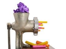 Picadora de carne que recicla o lixo e o papel colorido imagens de stock