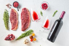 Free Picanha Organic Beef Steaks With Seasonings, Near Red Wine In Glasses And Bottle Over White Textured  Background, Top View Stock Photography - 198859252