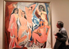 Picasso painting. Visitor in front of Picasso Avignon ladies at MOMA, New York Stock Photo