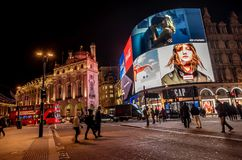 Piccadilly Circus with billboards,people and city traffic in Lon. London, United Kingdom- January 10, 2018: Piccadilly Circus with billboards,people and city Royalty Free Stock Images