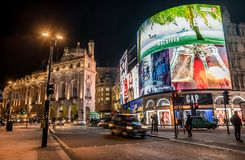 Piccadilly Circus with billboards,people and city traffic in Lon. London, United Kingdom- January 10, 2018:Piccadilly Circus with billboards,people and city Stock Photos