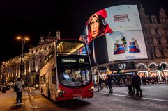 Piccadilly Circus with billboards,people and city traffic in Lon. London, United Kingdom- January 10, 2018:Piccadilly Circus with billboards,people and city Stock Photography