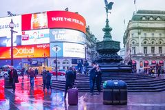 Piccadilly Circus is a famous London landmark and busy destination for tourists. LONDON, UK - JANUARY 12, 2017: Piccadilly Circus with the Shaftesbury Memorial stock images