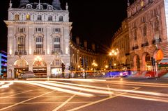 Piccadilly circus, famous road junction and public space of Lond. On& x27;s West End in the City of Westminster. Night shoot. Traditional victorian buildings Royalty Free Stock Photography