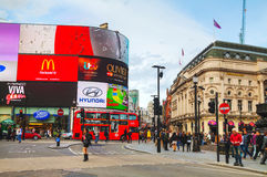 Piccadilly Circus junction crowded by people in London Royalty Free Stock Photo