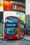 Piccadilly Circus junction with the red double decker bus in Lon Stock Image