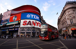 Piccadilly Circus, London. A typical double decker bus is passing trough Piccadilly Circus, the most famous road junction of London, UK royalty free stock photos