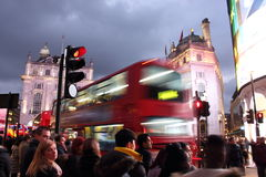 Piccadilly Circus, London - - February 14th of 2015: Lots of people. cars and typical red buses crossing the streets in this famou Royalty Free Stock Photos