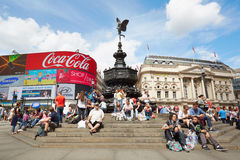Piccadilly Circus neon signage and Eros fountain in London. LONDON - AUGUST 6: Famous Piccadilly Circus neon signage and Eros fountain in the day. Signs have Royalty Free Stock Photo