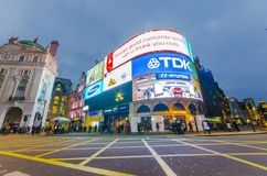 Piccadilly Circus at night in London. Famous Piccadilly Circus neon signage shines at night. These signs have become a major attraction of London in London Royalty Free Stock Images