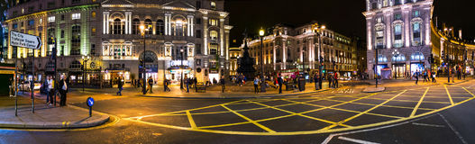Piccadilly Circus square at night in London, UK Stock Images
