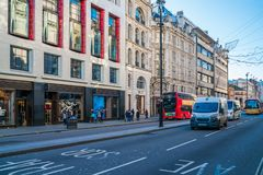 Piccadilly, London UK. LONDON DECEMBER 28, 2017: People and traffic in Piccadilly, known for its video display and neon signs mounted on the corner building as Royalty Free Stock Photo