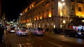 Piccadilly street view in London by night - LONDON, ENGLAND - DECEMBER 11, 2019