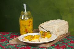 Piccalilli preserve on fresh bread. Traditional way of preserving summer crops.  Tast relish Royalty Free Stock Photography