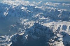 Picchi di montagna innevati Fotografie Stock