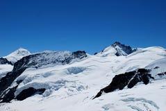 Picchi di montagna isolati Fotografia Stock