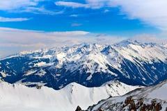 Picchi di Snowy delle alpi Immagine Stock Libera da Diritti
