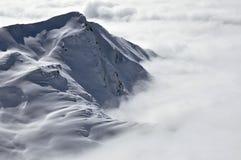 Picchi sopra le nubi, inverno nelle alpi austriache Fotografia Stock