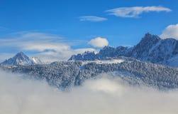 Picchi sopra le nuvole Immagine Stock
